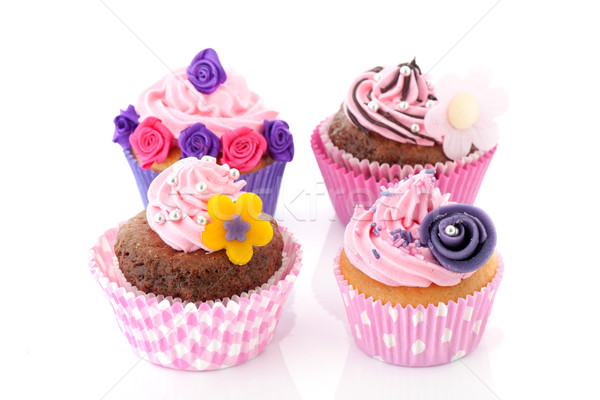 Four colorful cupcakes Stock photo © ivonnewierink