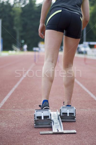 Elvesz akadályok lány néhány fű sportok Stock fotó © ivonnewierink