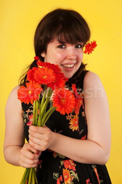 Teen girl pomarańczowy bukiet młodych kwiat włosy Zdjęcia stock © ivonnewierink