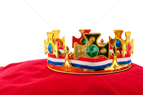Golden crown on velvet pillow with Dutch flag Stock photo © ivonnewierink