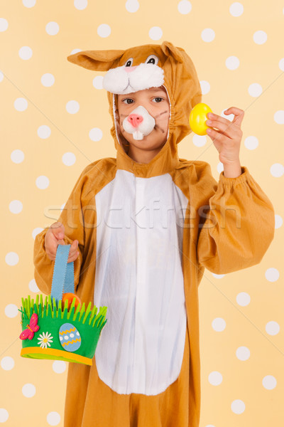 Child as easter hare with eggs Stock photo © ivonnewierink