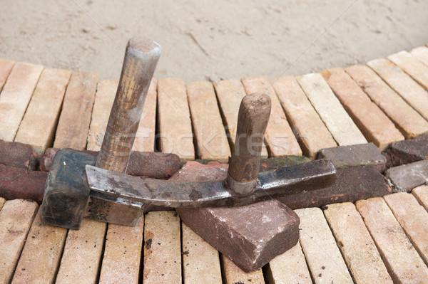 Nowego bruk pracy narzędzia zewnątrz Zdjęcia stock © ivonnewierink