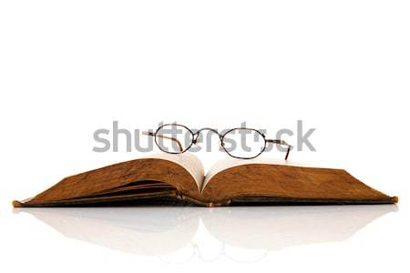 Old book with reading glasses Stock photo © ivonnewierink