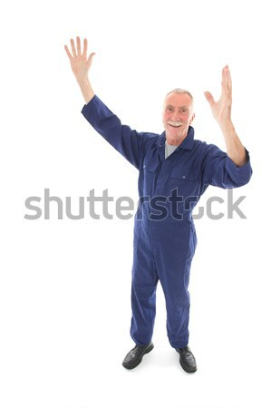man in blue overall cheering Stock photo © ivonnewierink