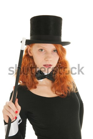 Woman dressed for party taking hat off Stock photo © ivonnewierink