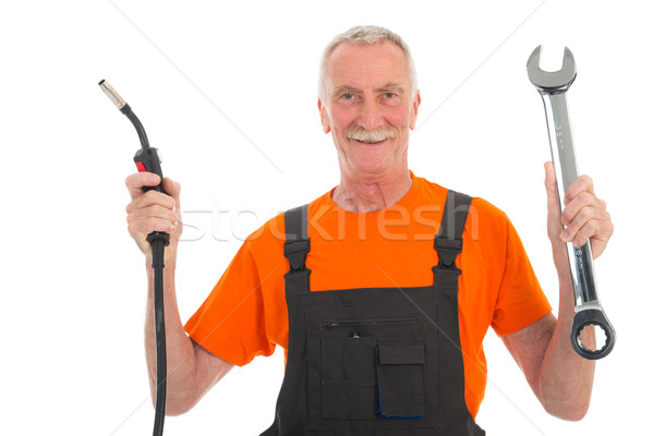 Happy man in orange and gray overall with wrench Stock photo © ivonnewierink
