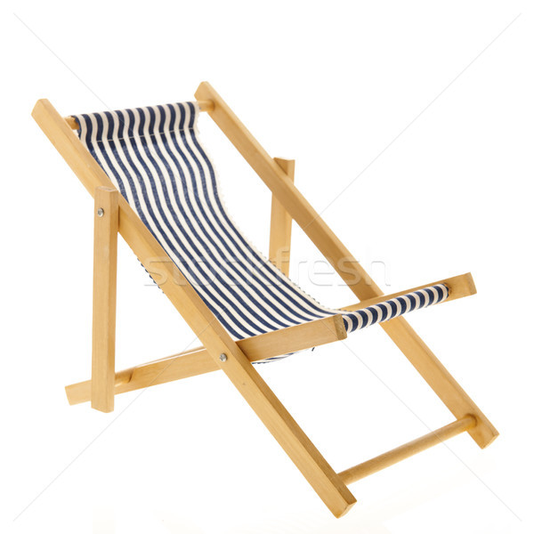 Blu strisce sedia a sdraio isolato bianco spiaggia Foto d'archivio © ivonnewierink