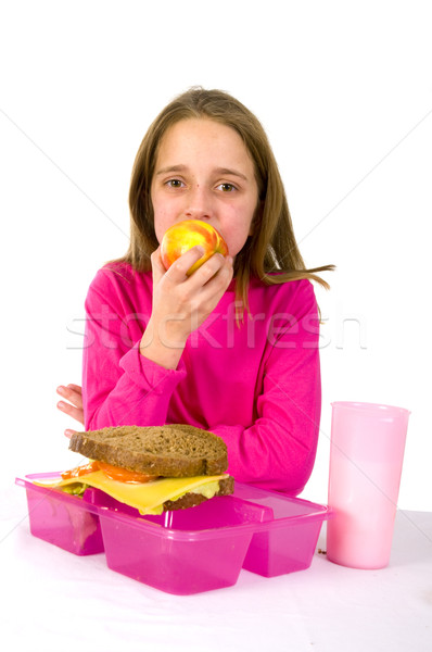 Mangiare mela pranzo scuola ragazza alimentare Foto d'archivio © ivonnewierink