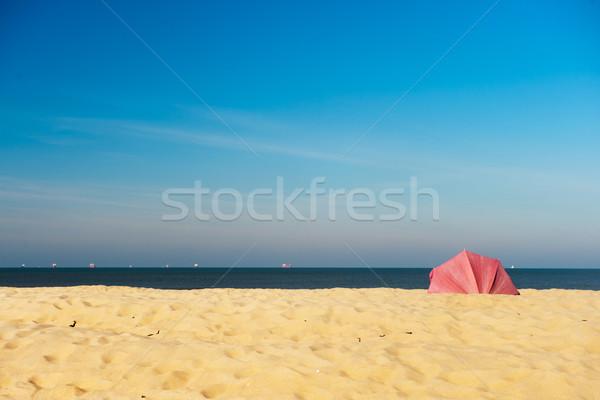 Güneş şemsiyesi boş plaj kırmızı kum su Stok fotoğraf © ivonnewierink