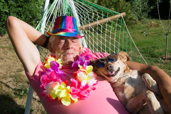 Hombre perro hamaca flores gafas de sol dormir Foto stock © ivonnewierink