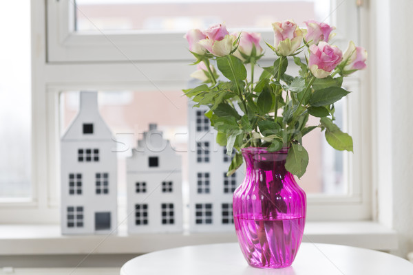 Roses in vase in interior Stock photo © ivonnewierink