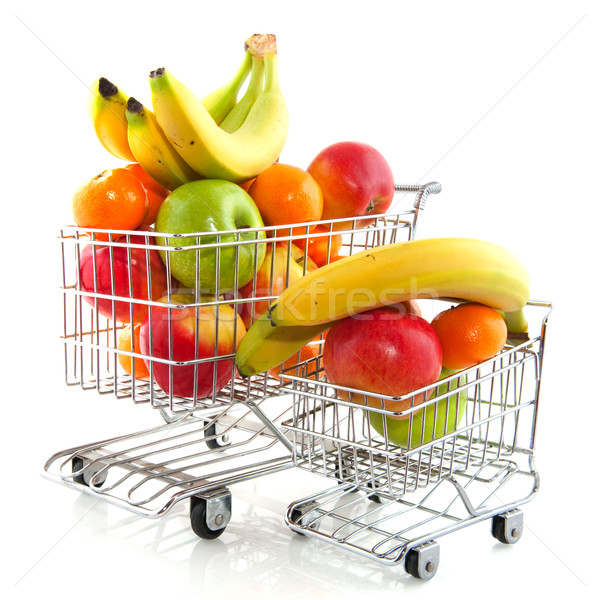 Bevásárlókocsi gyümölcs áruház friss gyümölcs kék piros Stock fotó © ivonnewierink