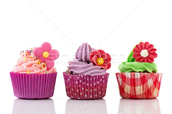 Színes minitorták virágok csetepaté vajkrém konfetti Stock fotó © ivonnewierink