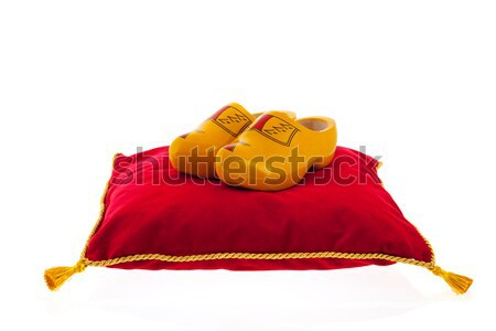 Royal red velvet pillow with wooden clogs Stock photo © ivonnewierink