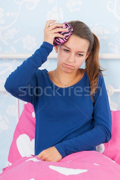Teen girl with headache Stock photo © ivonnewierink