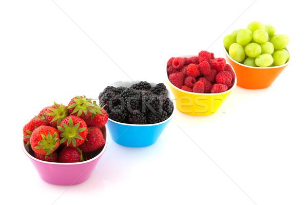 Fraîches fruits d'été coloré bols isolé blanche Photo stock © ivonnewierink