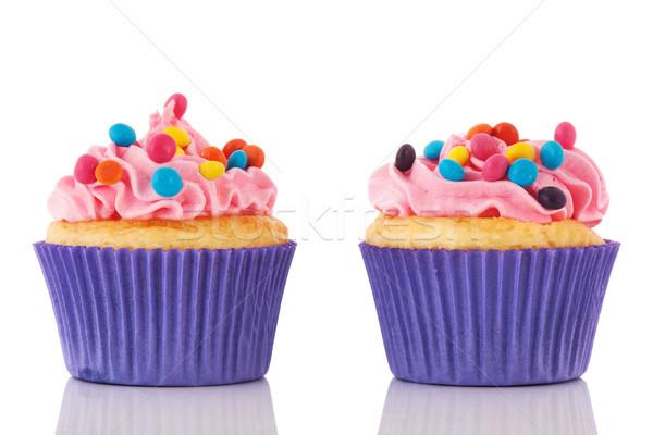 Születésnap minitorták konfetti rózsaszín vajkrém izolált Stock fotó © ivonnewierink