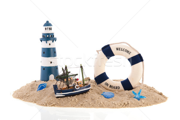 Coast with lighthouse ans fishing boat Stock photo © ivonnewierink