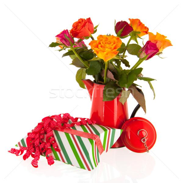 Virágcsokor rózsák váza ajándékok színes piros Stock fotó © ivonnewierink