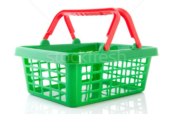 Zöld műanyag bevásárlókosár üres piros háttér Stock fotó © ivonnewierink