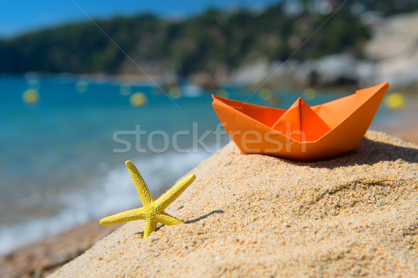 Paper boat and starfish at the beach Stock photo © ivonnewierink