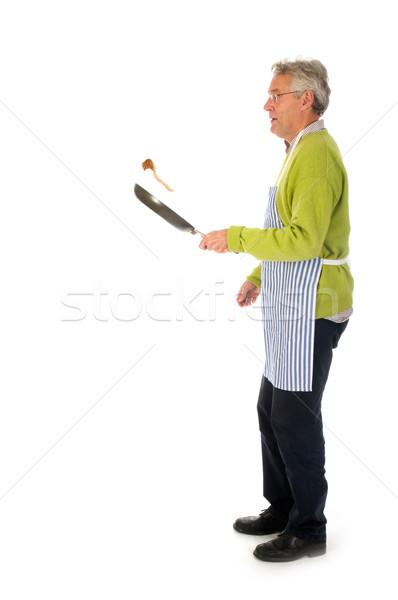 Senior man is baking Stock photo © ivonnewierink