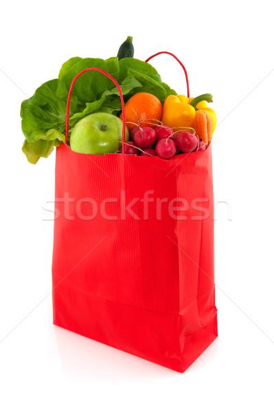 Orange paper bag with healthy food Stock photo © ivonnewierink