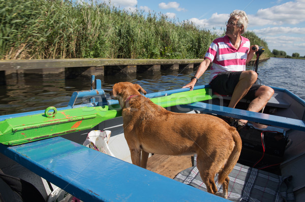Man with dog in the boat Stock photo © ivonnewierink