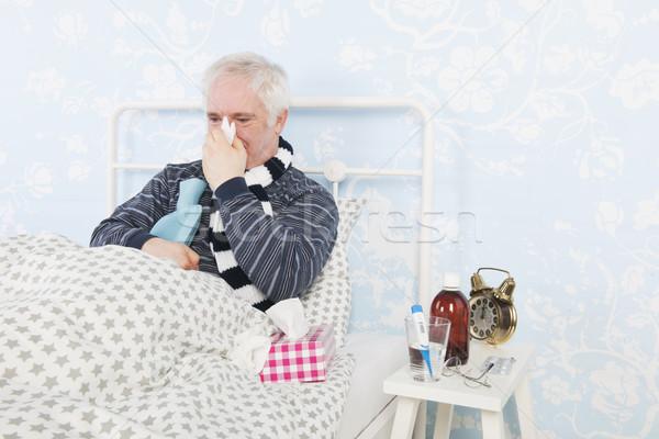 Senior homem gripe doente cama água quente Foto stock © ivonnewierink