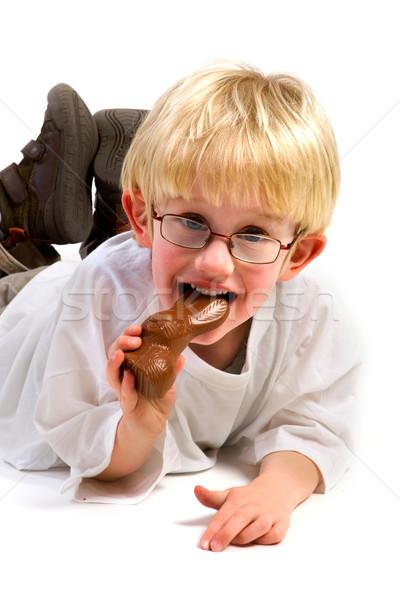 Czekolady Wielkanoc zając mały chłopca jedzenie Zdjęcia stock © ivonnewierink