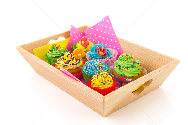Colorful cupcakes on wooden tray Stock photo © ivonnewierink