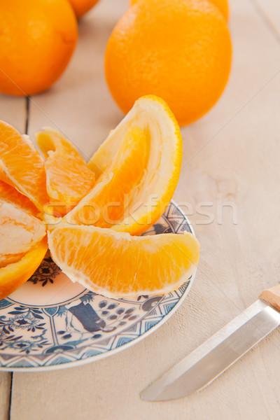 Peeling fresh orange Stock photo © ivonnewierink