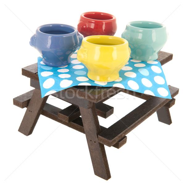 Picknicktafel soep kommen geïsoleerd witte achtergrond Stockfoto © ivonnewierink