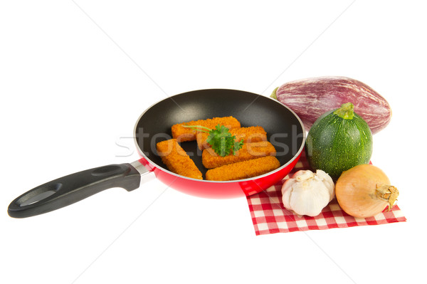 Red frying pan with fish sticks Stock photo © ivonnewierink