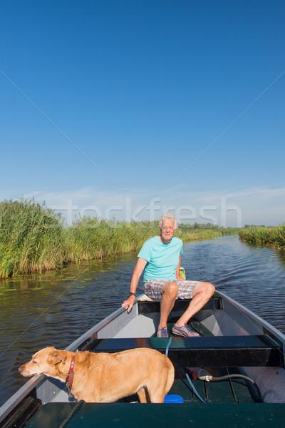 Idős férfi kutya motorcsónak természet víz Stock fotó © ivonnewierink