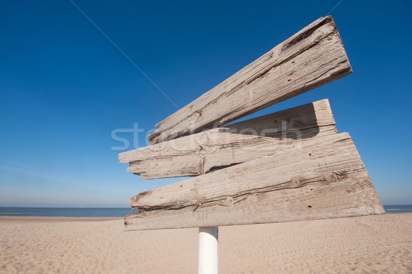Empty wooden direction sign Stock photo © ivonnewierink