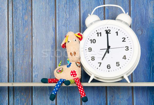 Stuffed animal giraffe and clock for bedtime Stock photo © ivonnewierink