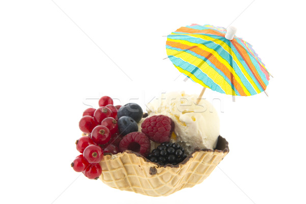 Cup vanilla ice with fruit and parasol Stock photo © ivonnewierink