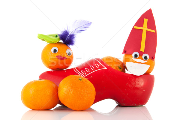 Dutch Sinterklaas and black Peten as mandarins in clog Stock photo © ivonnewierink