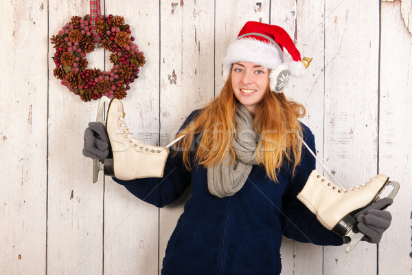 Christmas woman in winter with ice skates Stock photo © ivonnewierink