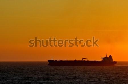 грузовое судно закат океана воды морем лодка Сток-фото © ivonnewierink