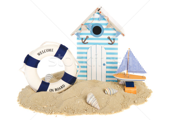 Beach hut with sailing boat and life buoy Stock photo © ivonnewierink
