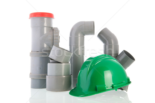 PVC pipes with green helmet Stock photo © ivonnewierink