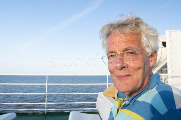 Homem navio de cruzeiro idoso sessão convés mar Foto stock © ivonnewierink