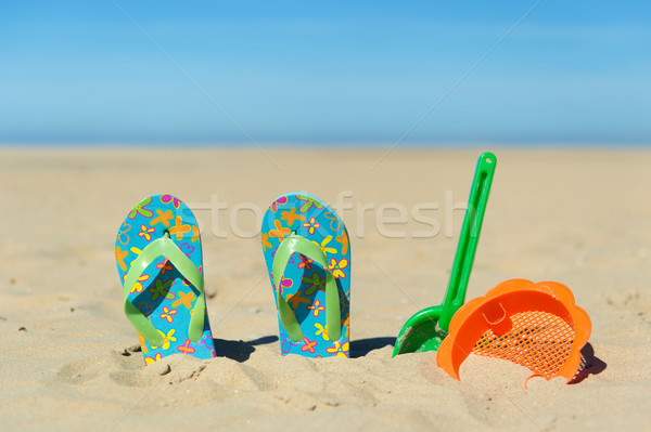 Flip flops and toys at the beach Stock photo © ivonnewierink
