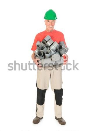 Encanador muitos pipes pvc homem Foto stock © ivonnewierink