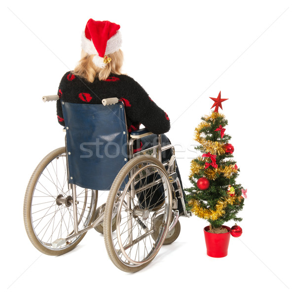 woman in wheel chair with Christmas tree Stock photo © ivonnewierink