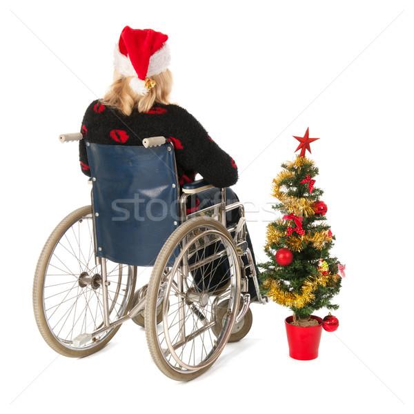 Mulher roda cadeira árvore de natal loiro cadeira de rodas Foto stock © ivonnewierink