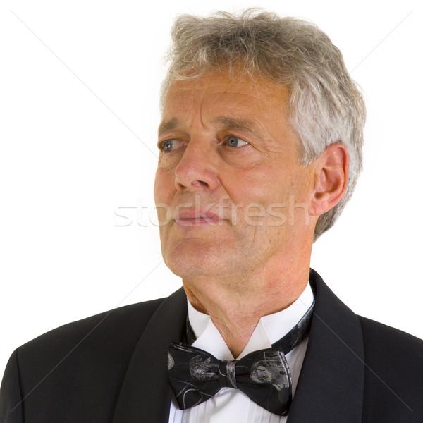 Jólöltözött portré idős férfi csokornyakkendő stúdió Stock fotó © ivonnewierink