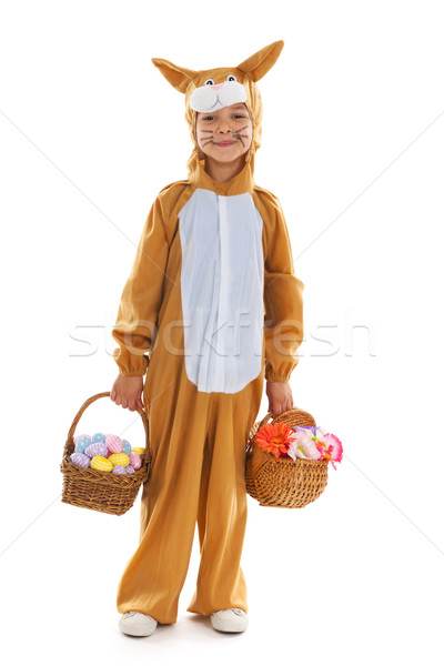 Child as easter hare with eggs and flowers Stock photo © ivonnewierink